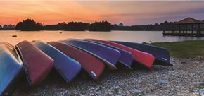 canoes on the shore at sunset