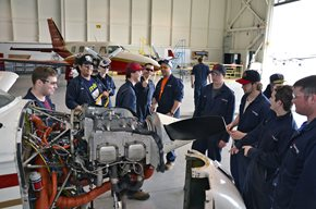 Group of students working in hangar