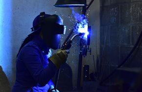 Female student welding