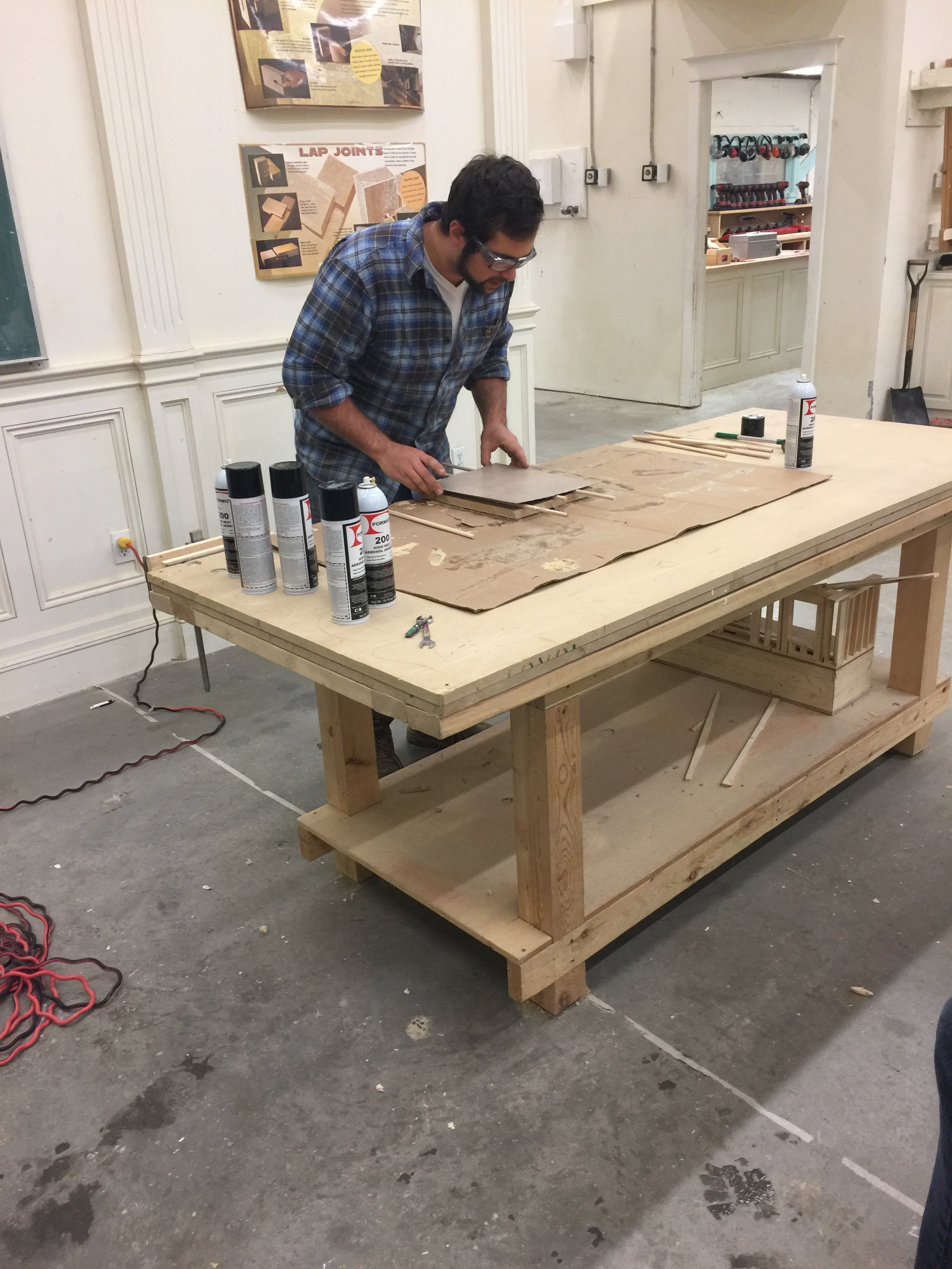 Guy showing how to lay laminate