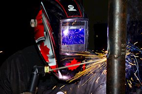 Student welding a pipe