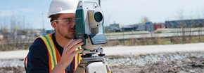 Guy using surveying equipment