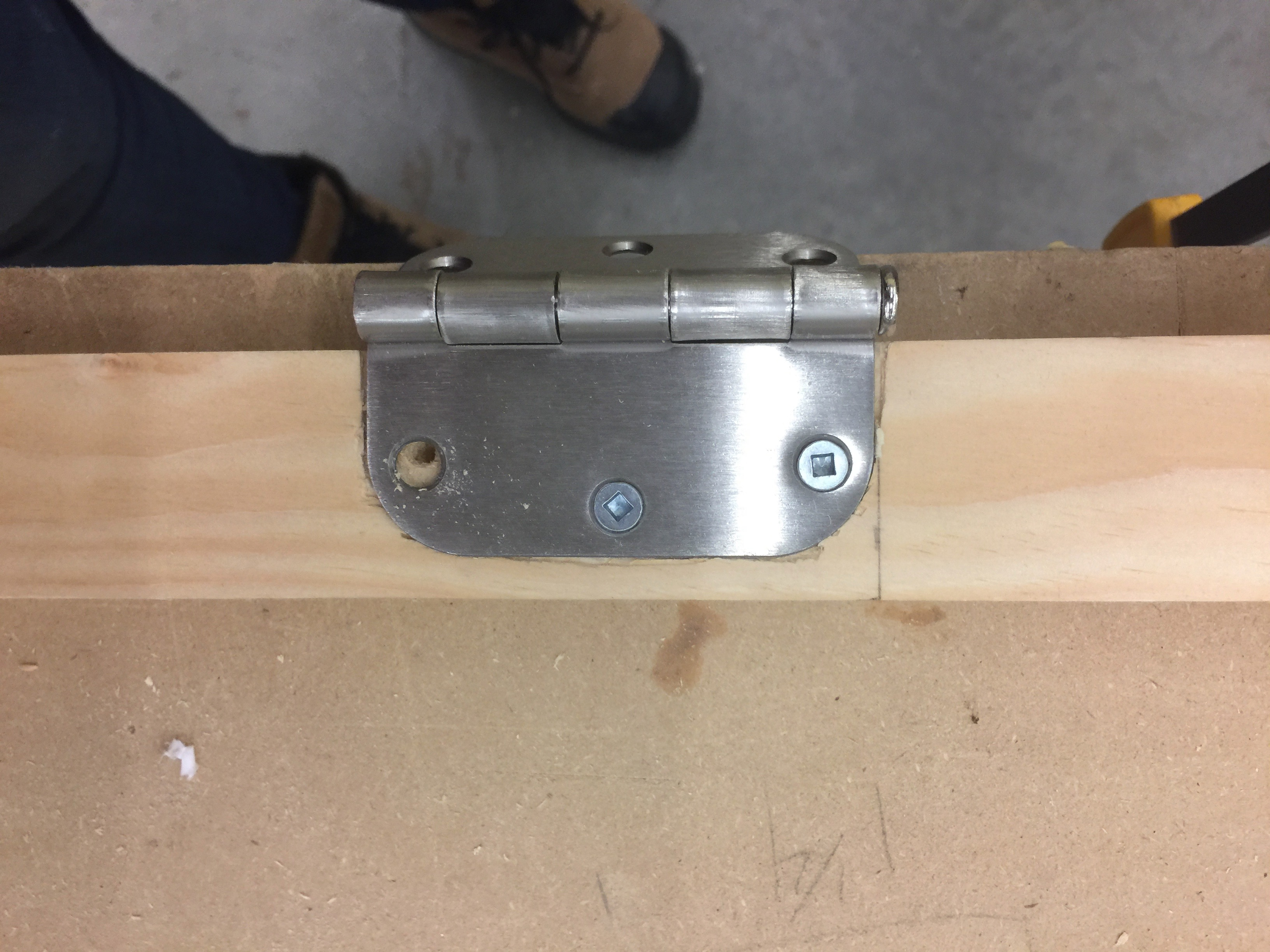 Attaching hinges to a piece of wood