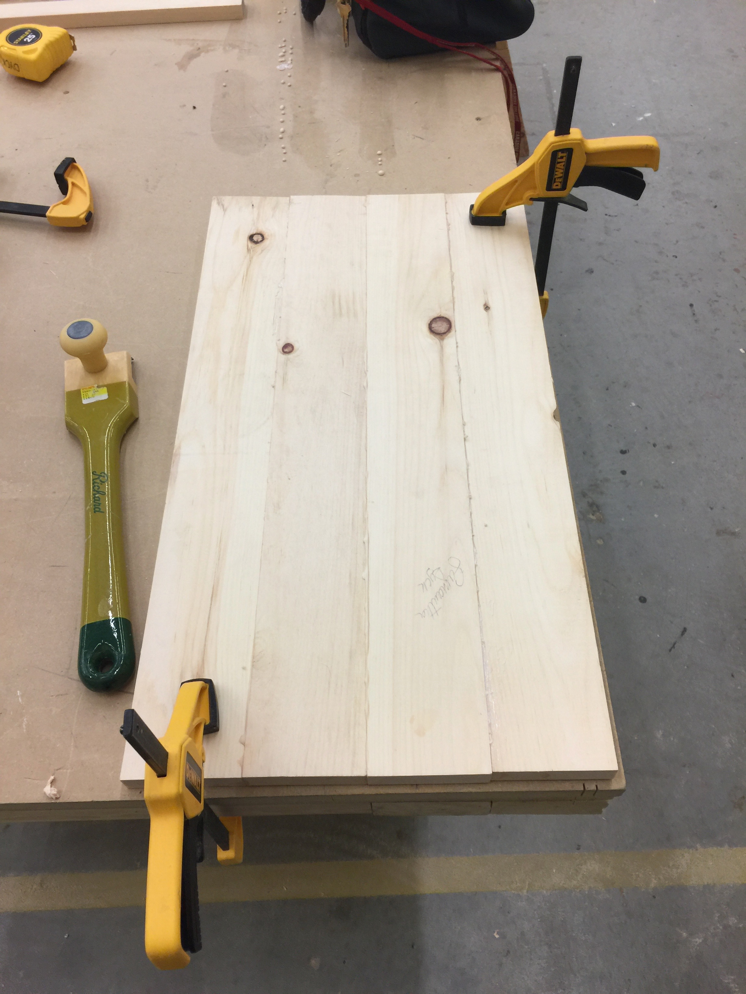 Wood clamped down