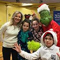 kids posing with the grinch