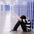 boy alone in an empty corridor with blue lockers icon