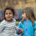 Girls holding hands in schoolyard