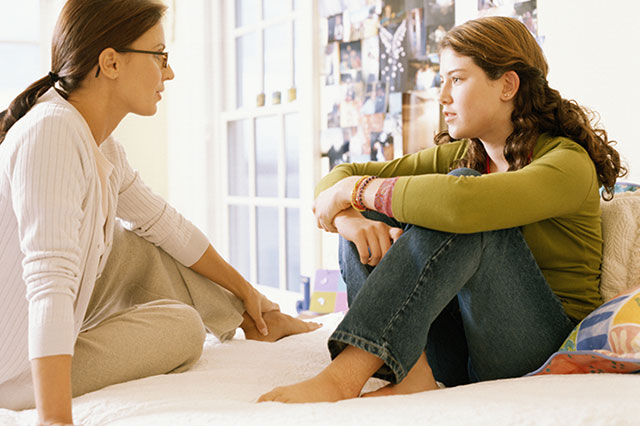mom talking to teenager at home