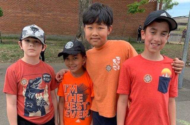 four kids wearing orange t-shirt