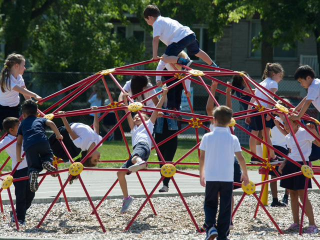 students playing on jungle gym
