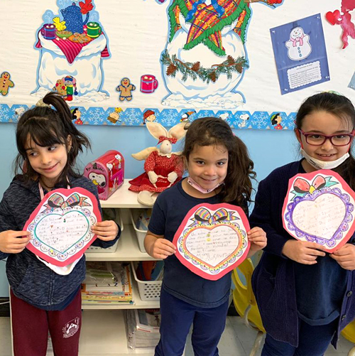 kids holding hearth paper craft