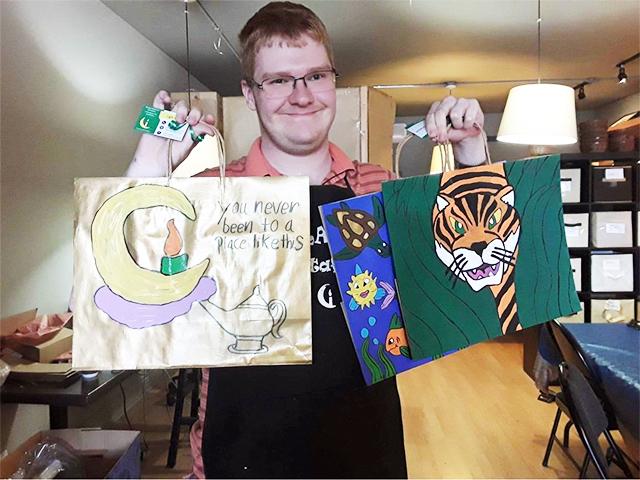 Inspirations Entrepreneurial Award recipient Brandon Riddoch sharing samples of his artwork. (Photo, Jodie Lennon)