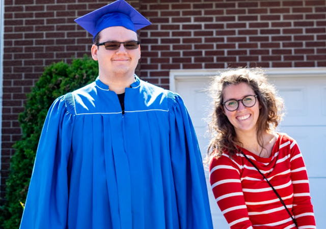 Graduate Devon and his teacher Chrissy Bell