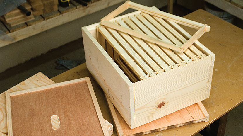 The essential components of a Langstroth hive include the outer cover ...