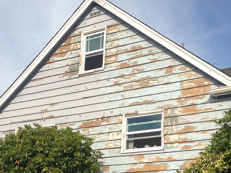 Blue paint flaking off house after pressure washing