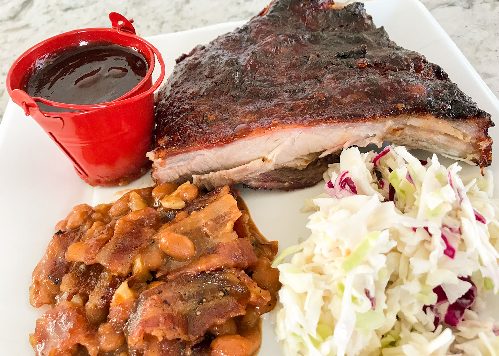 A plate of barbecued food