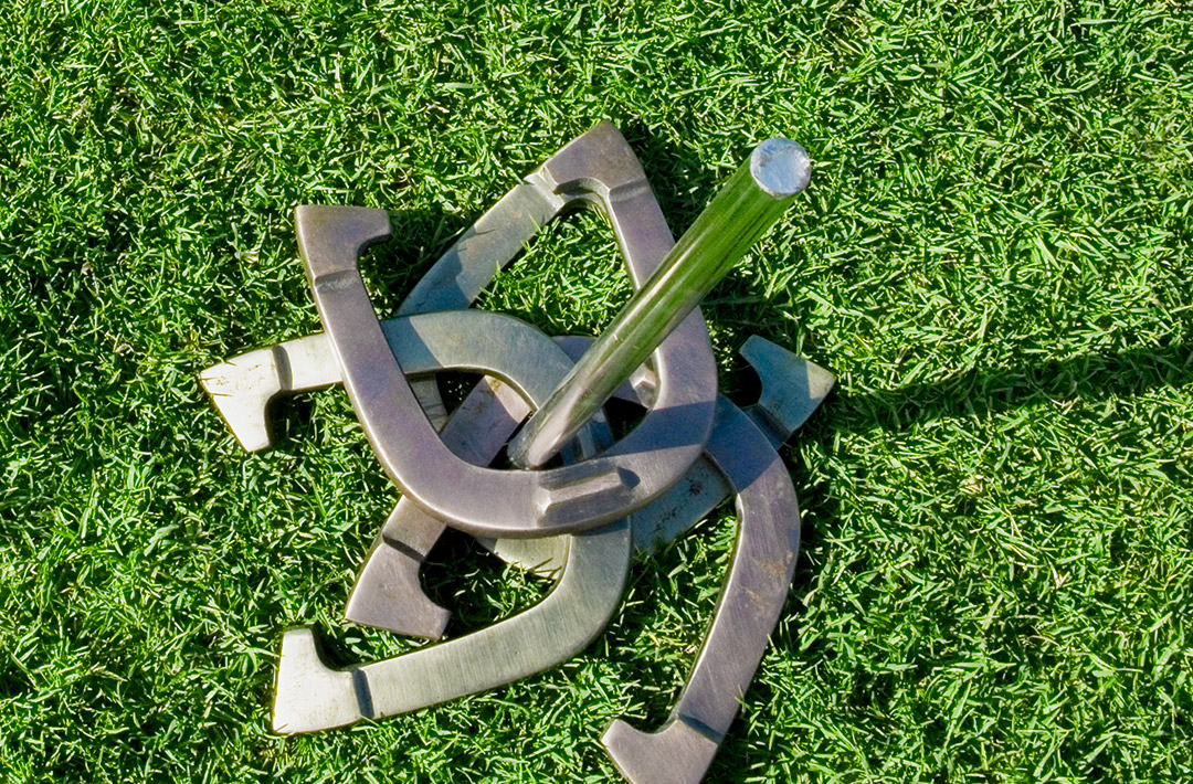 Horseshoes looped around a rod