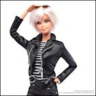 Barbi with leather jacket posing for photo