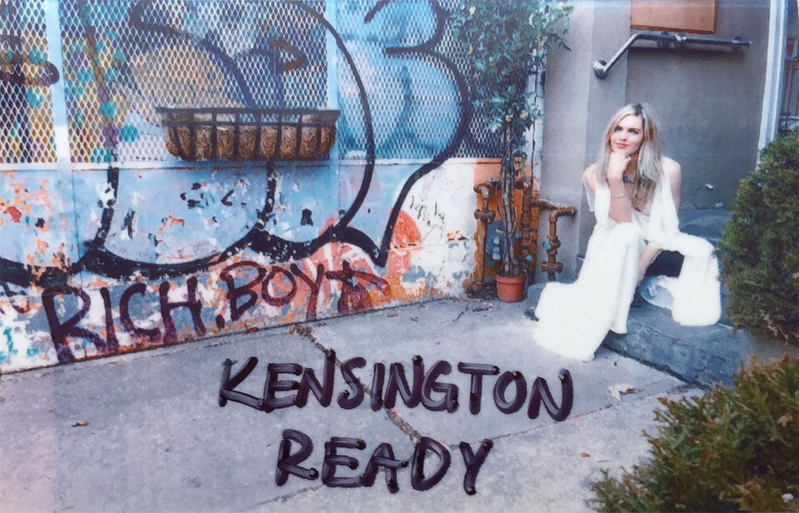 girl posing next to wall - kensington ready