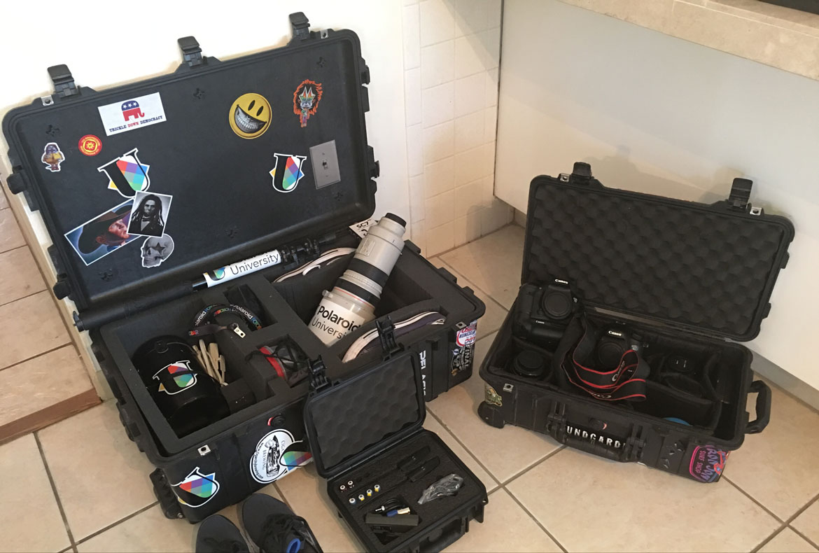Camera travel case with Polaroid cameras, stickers, other equipment