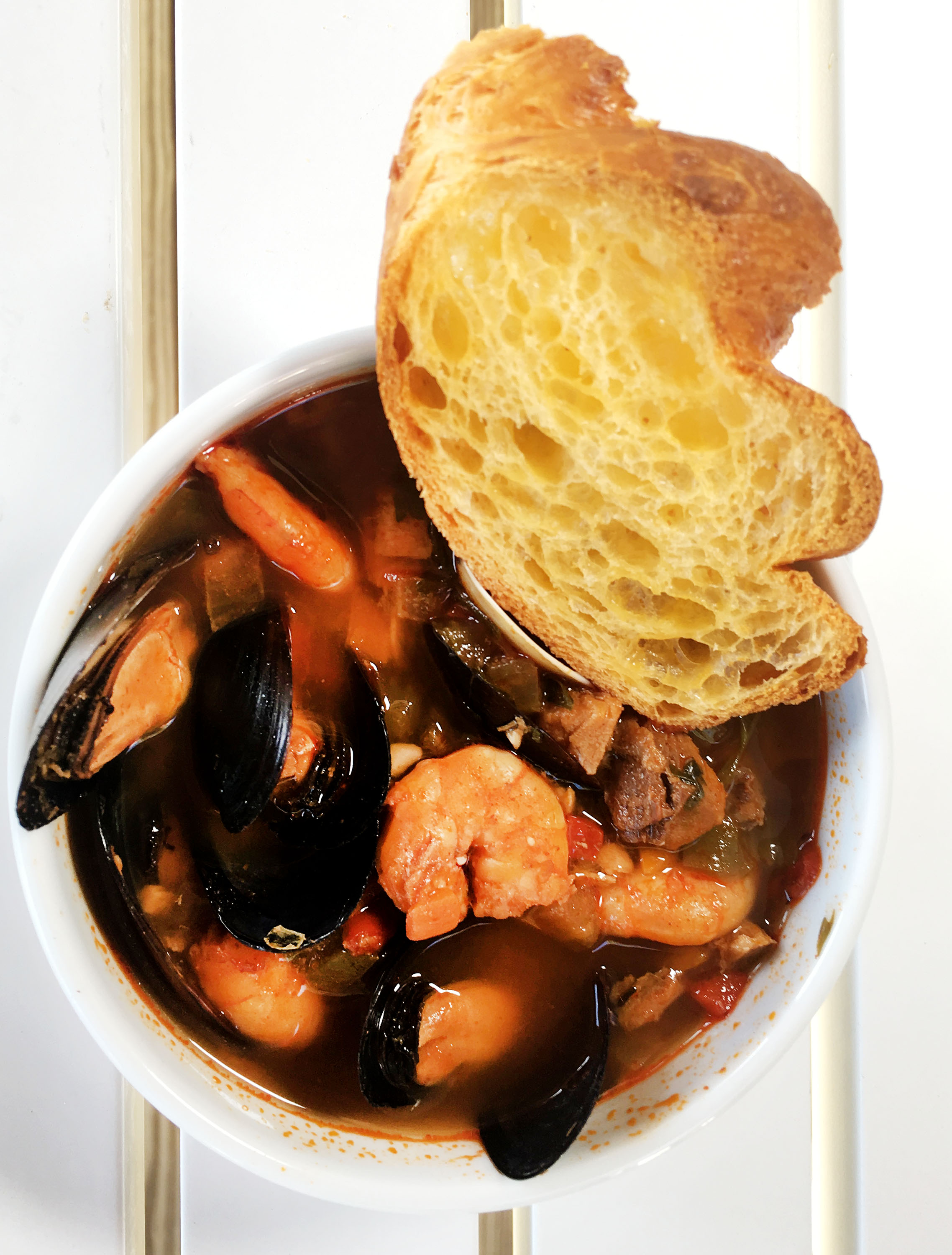 bowl of seafood with bread