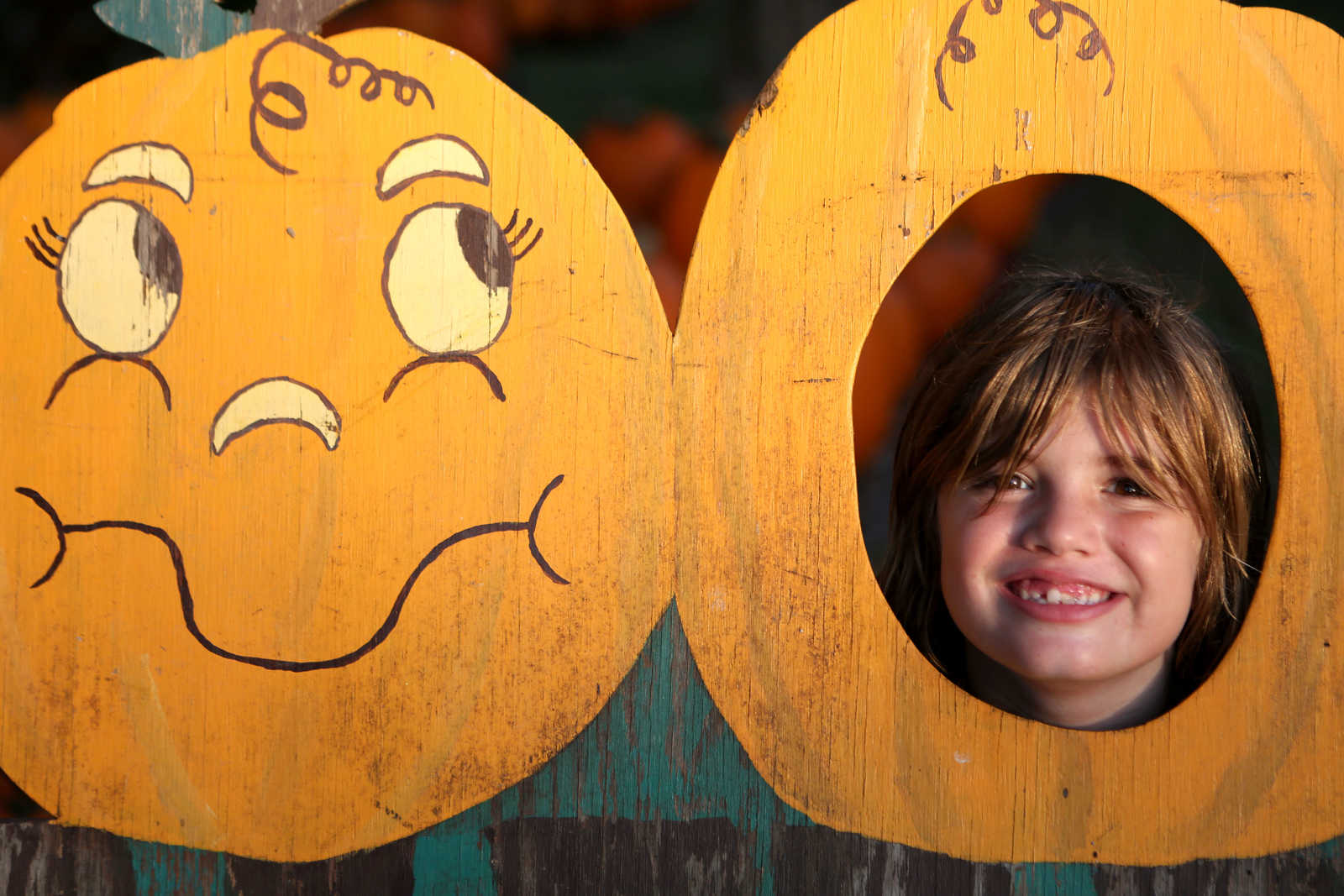 Photo of a boy in pumpkin cardboard cutout that demonstrate the rule of thirds
