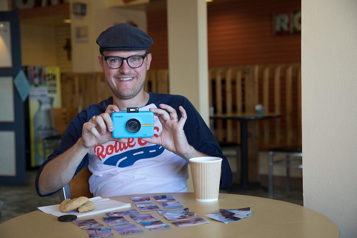 Photo of Matthew Dickey holding a Polaroid Snap Instant Digital Camera