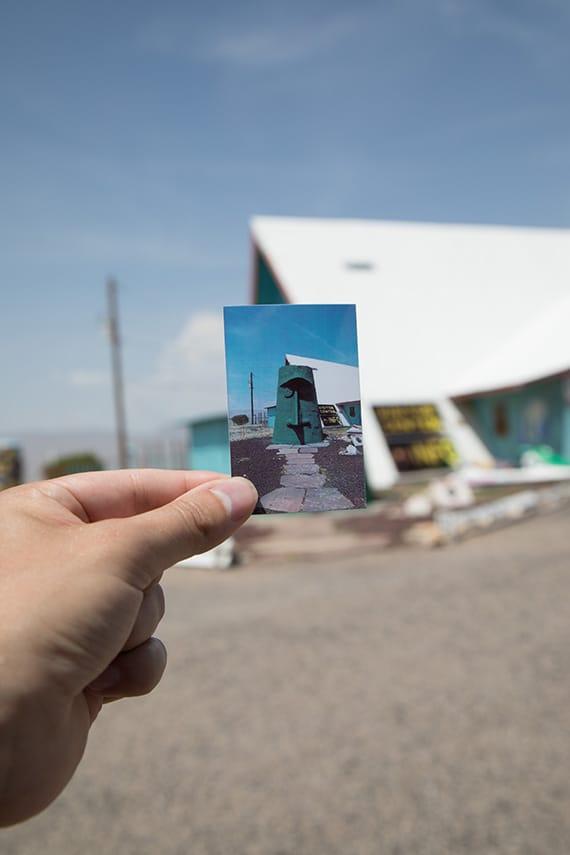 Polaroid photo of the Giganticus Headicus in front of the actual location