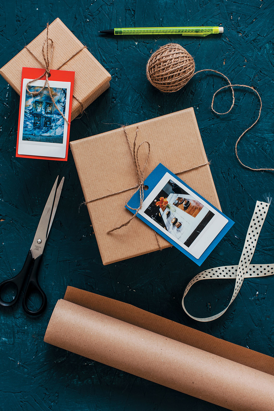 gifts wrapped and tagged with a Polaroid picture