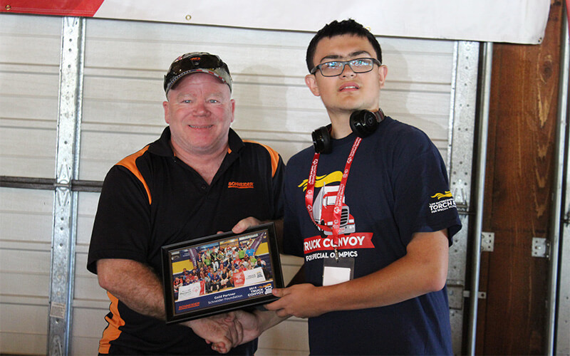 Schneider driver poses for a Special Olympics Convoy photo