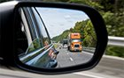 Tractor-trailer in car mirror