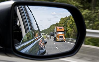 Tractor-trailer in car mirror