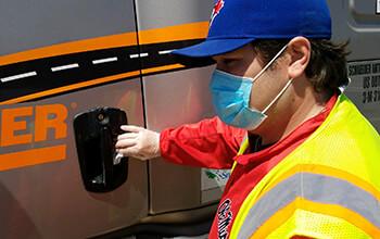 Truck driver disinfecting a semi truck