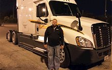 Seth Heiss in front of a Schneider truck
