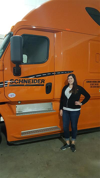 Katie Nohre in front of truck