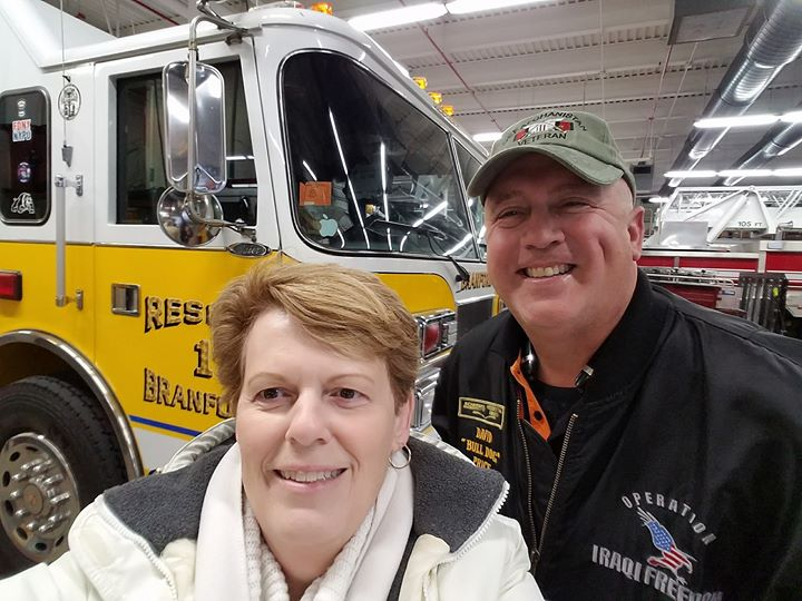 Gold Star mother Molly Morel and Schneider Ride of Pride driver David Price take a selfie together