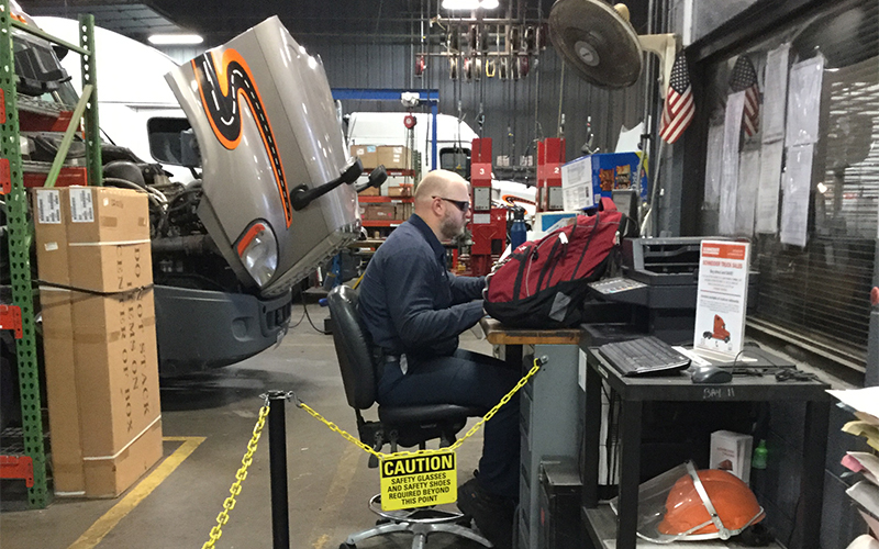 Schneider Mechanic sitting at desk