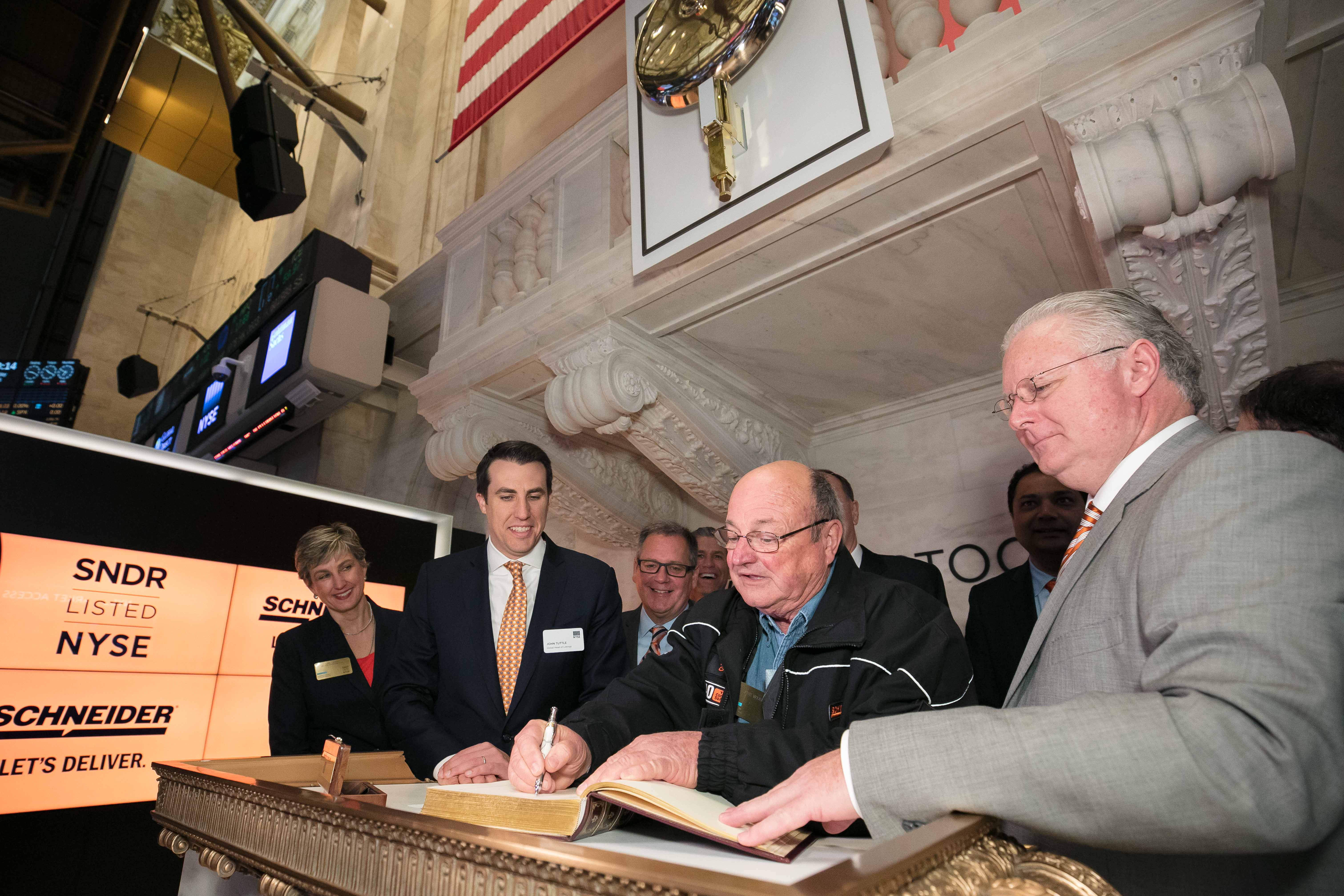 Schneider Driver Signing NYSE Book of Distinguished Guests