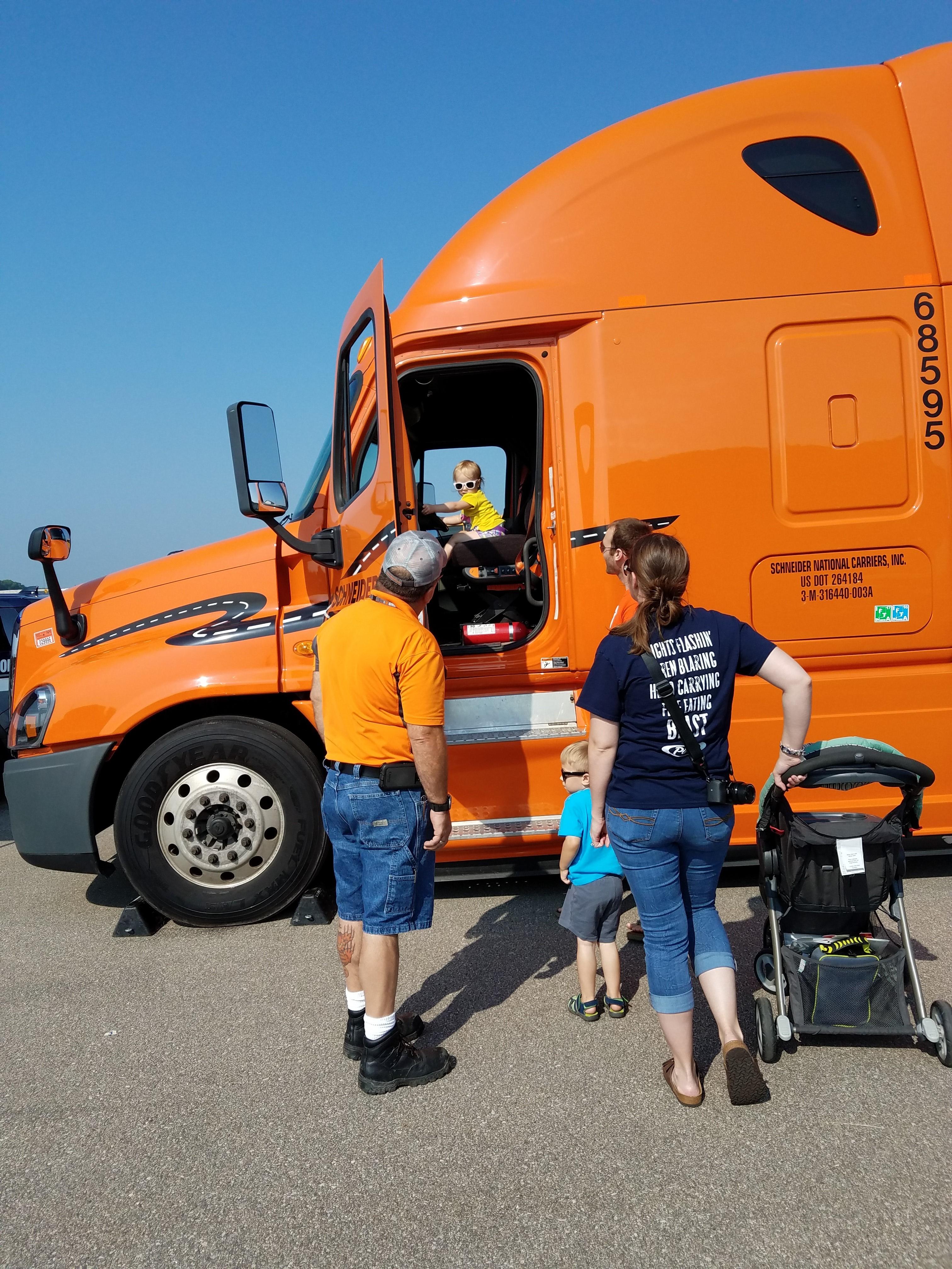 Child in Schneider truck