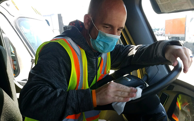 Truck driver wearing mask earning Performance Pay Plus