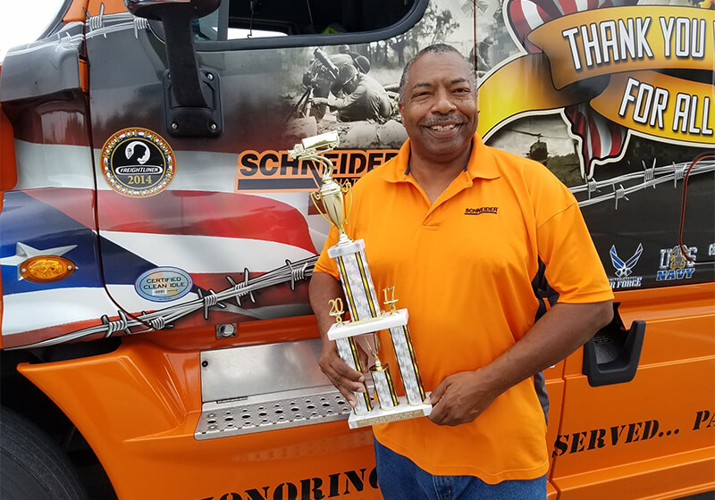 Randy receiving an award for his 2014 Schneider Ride of Pride truck