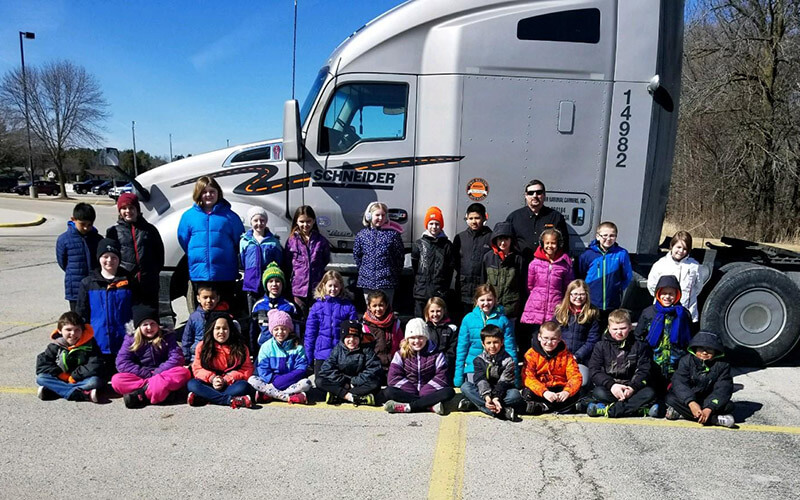 Reedsville Elementary class posing in front of Rod's semi-truck