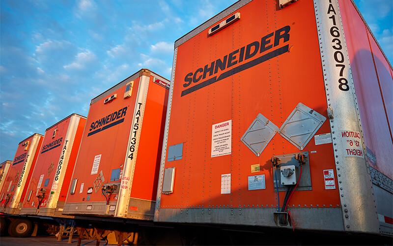 Rows of Schneider trailers