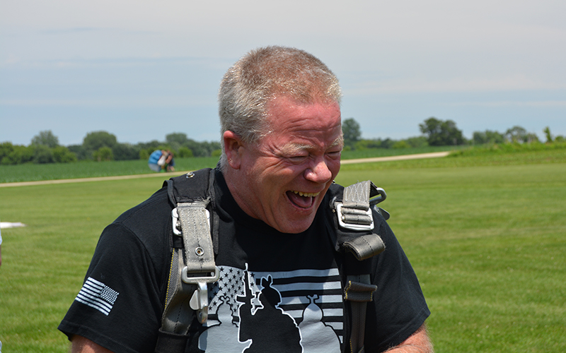 Schneider Veteran and driver Chip After Skydiving Smiling