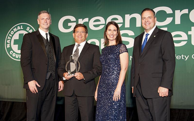 Schneider associates receiving safety award
