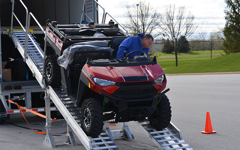 Schneider Dedicated driver delivering UTV off trailer