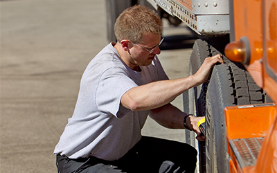 Driver checking tire