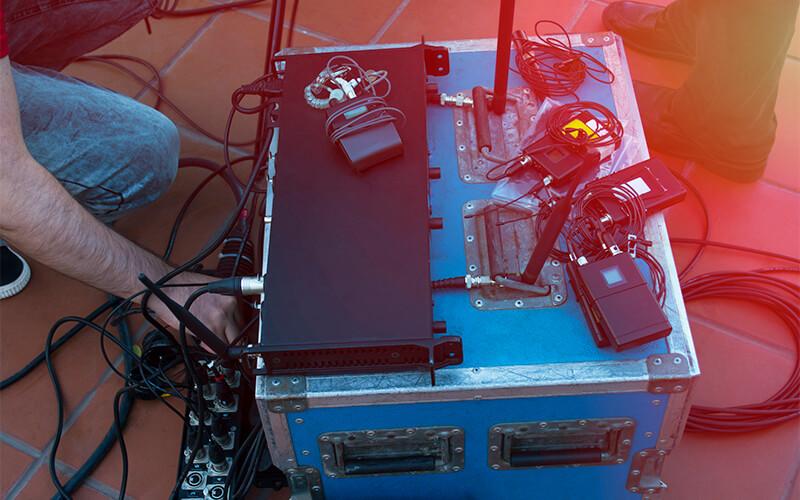 Roadie setting up equipment
