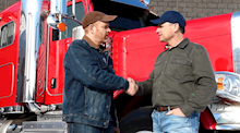 Truckers shaking hands