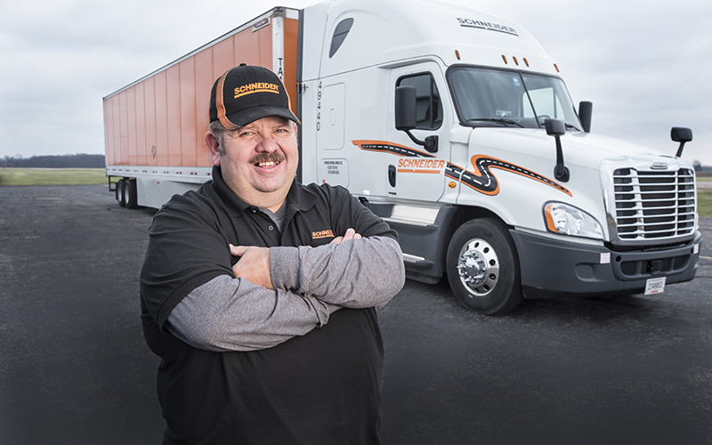 Van Dedicated All-Star driver Bill Mahanes poses in front of his truck.